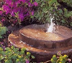 Water Wheel  Use new or salvaged grinding wheels to construct this unique garden accent. Sinking the water reservoir into the soil gives the fountain a low profile that makes it perfect around smaller plants.