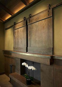 Imagine if there was a way to have doors like these open\close off a loft.... Tv_above_fireplace_4