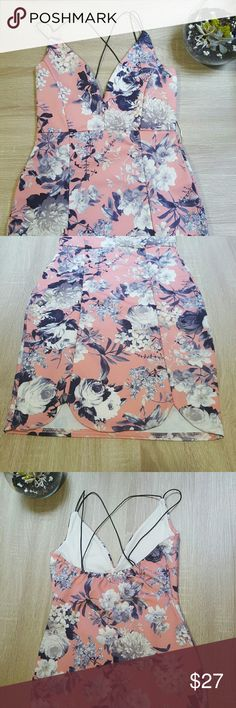 Floral bodycon dress Pink floral bodycon dress with thin black straps that criss cross in the back. Like new condition. Boohoo Dresses Mini