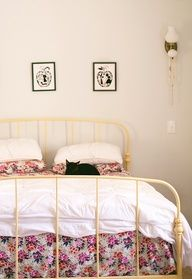 Wrought Iron Bed Lovely Floral Sheets And A Kitty