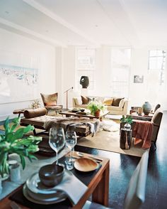 Modern Living Room Photo - An open living-dining space filled with earth-toned furniture