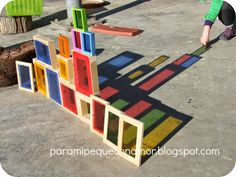 Coloured blocks outside in the sunshine add a new dimension to explore while building.