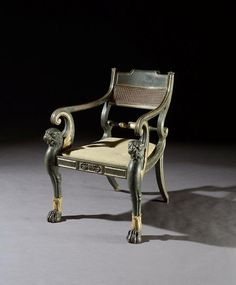 - An exceptional and impressive Regency period carved, bronzed and gilded armchair
