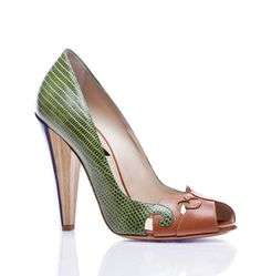 Green lizard-printed leather with natural calf is meticulously worked into an interesting swirl design on this open toe pump. A wood and acrylic heel is a new twist to this elegant shoe with an edge. For an optimal fit for this shoe, we suggest ordering a half size up. Limited inventory available.