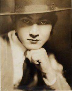 Rudolph Valentino, White Studio Portrait. The way the hat shades his eyes is perfect,