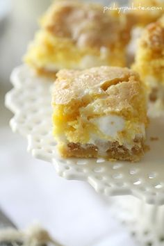White Chocolate S'mores Gooey Cake Bars ... Easy - different - everyone will want the recipe!  Here is your line-up…Yellow cake mix (plus 1 stick of butter and 1 egg), a bag of white chocolate chips, sweetened condensed milk, graham crackers and some mini marshmallows.  See easy recipe with this pin. My family went crazy over these at our reunion!!! My absolute fav recipe of all!!!!!!!