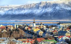 """""""A stunning backdrop pronounces Iceland's picturesque capital: on one side of town stand rows of prim coloured rooftops outlined by a silvery, duck- and swan-filled lake. On the other, city streets slope down to the wind-capped bay of Faxaflói and a pair of quiet, bright-green islands. The mighty ridge of Mt Esja rises in the distance, perhaps the most treasured landmark in Reykjavík."""" Iceland: the Bradt Guide; www.bradtguides.com"""