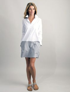 We've gone schoolgirl chic with The Skirted Shirtdress. Created with crisp pinpoint shirting, our Skirted Shirtdress, tailored with a drop waist skirt attached, features a button-down style white top