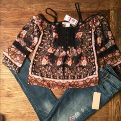 ⚡️Flash Sale⚡️New American Rag peasant top w/ lace Adorable American Rag Cie sheer peasant style top with wide 3/4 length sleeves. Gorgeous lace details on sleeves and chest. Floral print has a black background with neutral tones on beige, pinks, brown and orange. Levi's are listed separately. American Rag Tops Blouses