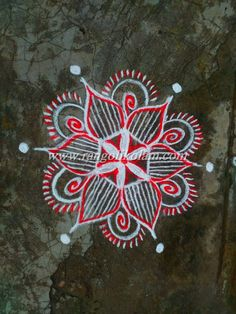 Its freehand white with bright  kavi  flowerkolam on friday evening