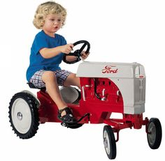 Ford Farm Tractor Pedal Car - Toychute -- It's possible this would be more of a gift for Tim than Teddy.
