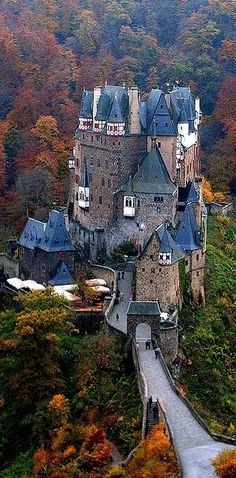 Burg Eltz Castle by Alex Shar. Burg Eltz is a medieval castle nestled in the hills above the Moselle River between Koblenz and Trier, Germany. It is still owned by a branch of the same family that lived there in the century, 33 generations ago Places Around The World, The Places Youll Go, Places To See, Around The Worlds, Beautiful Castles, Beautiful Buildings, Eifel Germany, Bavaria Germany, Burg Eltz Castle