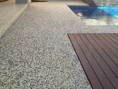 New exposed aggregate concrete patio stones Ideas Honed Concrete, Exposed Aggregate Concrete, Concrete Pool, Polished Concrete, Pool Paving, Pool Landscaping, Concrete Patio Designs, Small Outdoor Patios, Brick Patios
