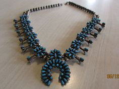 Beautiful Sterling silver and turquoise cluster squash blossom necklace Native American Zuni or Navajo made. Not signed. The naja center of this