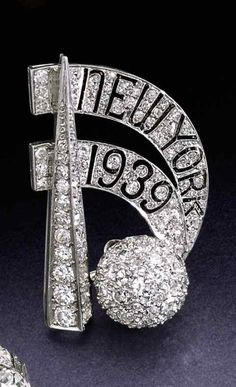 An Art Deco diamond brooch, circa 1939. The design inspired by the architecture of the 1939 New York World's Fair, set with old European and single-cut diamonds, numbered.