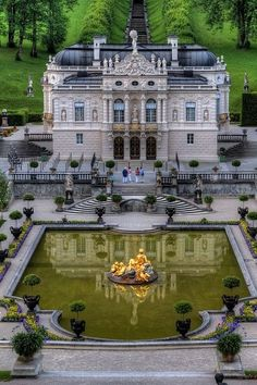 """Schloss Linderhof in Germany, in southwest Bavaria, is the smallest of the three palaces built by King Ludwig II of Bavaria, House of Wittelsbach. It is an ornate palace in neo-French Rococo style. Near the palace, at the foot of the Hennenkopf, the park contains a Venus grotto where Ludwig was rowed in a shell-like boat on an underground lake lit with red, green or """"Capri"""" blue effects by electricity, a novelty at that time, provided by one of the first generating plants in Bavaria"""