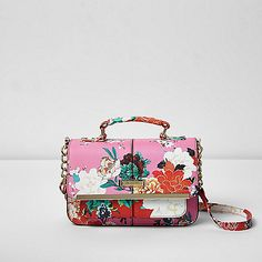 Floral print fabric Popper front fastening Grab handle Chain shoulder strap Front and inside zip pocket RI branding