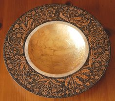 Wooden bowl decorated with pyrography, paint and gold leaf.