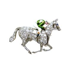 - Art Deco diamond and enamel horse and jockey brooch, c.1935