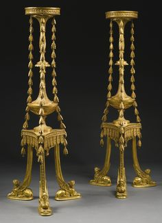 A fine and rare pair of George III giltwood torchères in the manner of Robert Adam circa 1775.