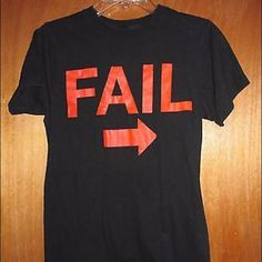 """Black Fail T-Shirt Sz S FAIL black t-shirt - has no tag.  Please see measurements below.  In great condition - some of the lettering is slightly cracked.  Measurements: Chest:  17""""""""  from armpit to armpit Waist:  16""""  across the front Total Length:  26"""" Unknown Tops Tees - Short Sleeve"""