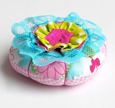 Colorful Pincushion With Flower on Top