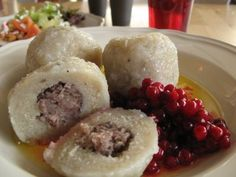 Swedish bak-zhang (meat dumpling), like a potato meatball accompanied with lingonberry.