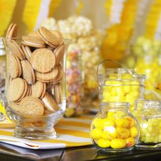 Yellow treat buffet with lemon drops, lemon heads, yellow bubble gum, yellow jelly beans, dipped pretzels, yellow taffy, mini banana candies, mini butterfingers, reese's, yellow donut holes, peeps, and yellow mini cupcakes.