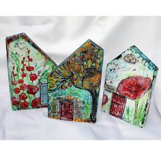 A recycled piece of wood turned into a mixed media house, Be. The house includes several mixed media techniques. It is 9.25 x 5.5 x1 piece of
