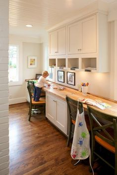 """built in desk with butcher block counters, in the play room for homework/art projects after they evolve from the """"kids table"""" and baskets & bins of toys, etc. paint chalkboard/magnetic wall opposite for notes, calendar, etc."""