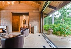 Natural Design Elements The home incorporated pine walls, Spanish cedar doors, timber frame cathedral ceilings and Sandstone flooring, which...