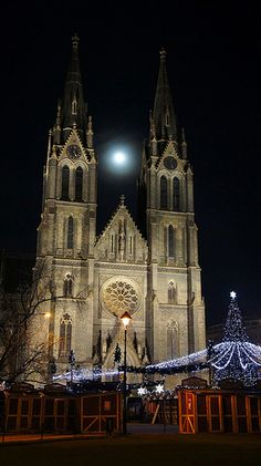 Prague (CZ) the moon between the St. Ludmila´s Cathedral steeples, or the Peace Square at Christmas time