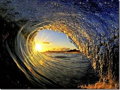 This picture of the ocean, wave and sun is very cool.