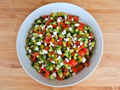 Israeli Salad dressed up with feta cheese, fresh mint, sweet bell peppers, olive oil, lemon, and cinnamon. Kosher, Dairy, Vegetarian, Side Dish