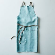 "Ocean Blue Cross-Back Kitchen Apron with Slate Ties One size fits most; 35"" L x 30"" W at hips, 10"" W at bib, adjustable straps about 60"" L; The adjustable straps are very long (about 60""), allowing the apron to be and tied around the front or tied in the back."