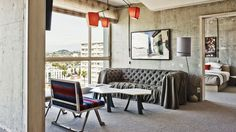 THE LINE HOTEL // Local designer Sean Knibb kitted out the 380 stripped-down rooms with raw concrete walls and floor-to-ceiling windows that look out at the Hollywood Hills, then furnished the spaces with pieces from his Venice Beach studio. Plan your visit at SurfaceHotels.com