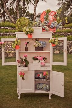 a vintage cabinet outfitted with bright blooms Photography by Studio Impressions Photography / http://studioimpressions.com.au, Floral Design by Bloomz Bali / http://bloomzflowersbali.com/, Event Planning by http://www.mnm-concepts.com/