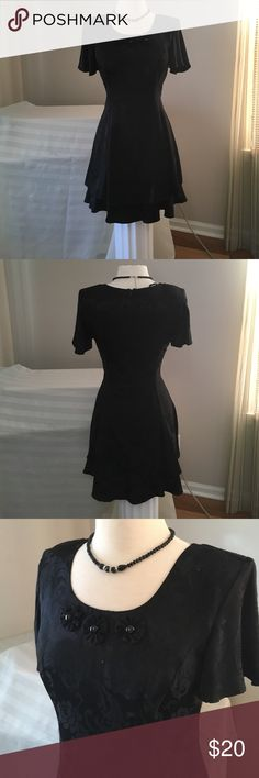 "Cute Black Evening dress Sz 6 Pretty ruffled sleeves with shoulder pads. Fitted bodice with two layered riffled skirt. The neckline has three flowers with centre beads. Armpit to armpit is 17"" with chest room. Waist 30"". Shoulder to hem 33.5"". CDC Dresses Mini"