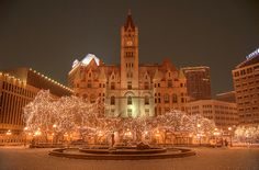 Rice Park in the Heart of Saint Paul, MN. You can see The Landmark Building right behind the lit trees. Then The Ordway Center for Performing Arts. Last but not least, The Saint Paul Hotel. 101 years old, beautiful with lots of stories to be told!
