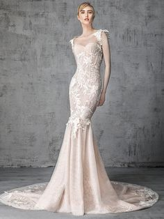 Victoria Kyriakides Spring 2019 Collection nude fit and flare wedding dress with sweetheart neckline and illusion long sleeves