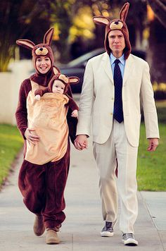 Alyson Hannigan and Alexis Denisof with baby Satyana are a family of Kangaroos on their first Halloween trick or treating as a family!