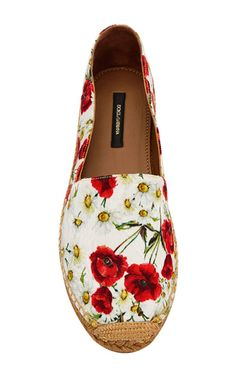 Italy's most renowned design duo use their intricate, finely crafted collections to celebrate a spirited vision of womanhood. These **Dolce & Gabbana** espadrilles feature a charming poppy print.