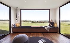 A picture window shows off the views in this eco-friendly prefab home in the coastal location of Inverloch, Victoria
