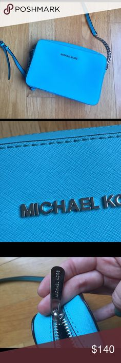 "Michael Kors Jet Set Crossbody Leather Baby blue, used once. Saffiano leather, 9""W x 4""H x 3/4""D. 25"" adjustable strap. Top zip closure. Exterior loge plaque. Beautiful baby blue and in absolute excellent condition. KORS Michael Kors Bags Crossbody Bags"