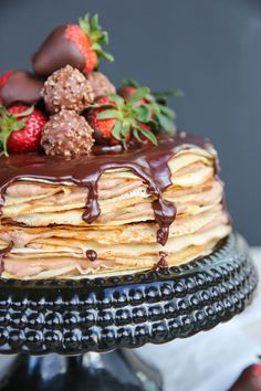 A delicious and decadent cake made by layering delicate crepes and sweet fillings. Looks amazingly impressive but it's not hard to make! Nutella Crepes, Chocolate Crepes, Nutella Cake, Chocolate Strawberries, Chocolate Hazelnut, Crepe Cake Chocolate, Nutella Mousse, Best Cake Recipes, Cookie Recipes