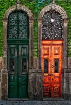 Side by side old wooden doors....