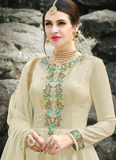 Cream Floral Embroidered Silk Anarkali Suit features a gorgeous silk anarkali suit alongside a crepe inner. A georgette dupatta completes the look. Embroidery work is completed with zari, thread, and stone. Embroidery Suits Punjabi, Embroidery Suits Design, Embroidery Fashion, Embroidery Dress, Hand Embroidery, Punjabi Suits Designer Boutique, Boutique Suits, Indian Designer Suits, Silk Anarkali Suits