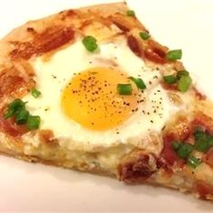 """Dad's Breakfast Pizza   """"This is one of our favorite breakfasts. I like it because it's so simple and the family likes it because they get bacon and eggs on a pizza."""""""