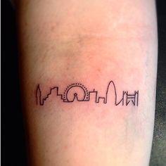Small & cute London skyline tattoo
