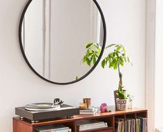 Umbra Oversize Hub Mirror: at three feet in diameter, this minimalist sphere has the power to brighten even a low-lit space.